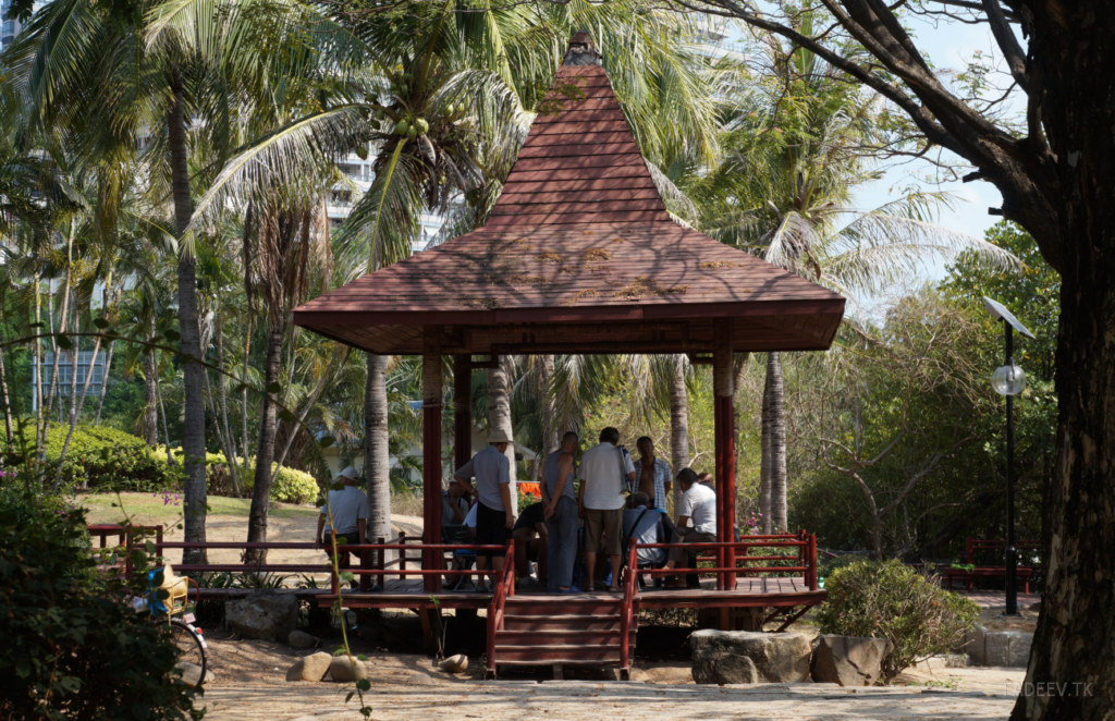 Residents have a rest in a park in Sanya, Hainan Island, China