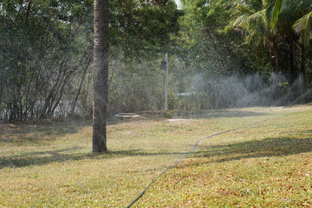Grass irrigation in a park, Sanya, Hainan Island, China