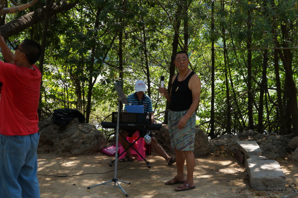 Amateur musicians prepare to perform in a park in Sanya, Hainan Island, China