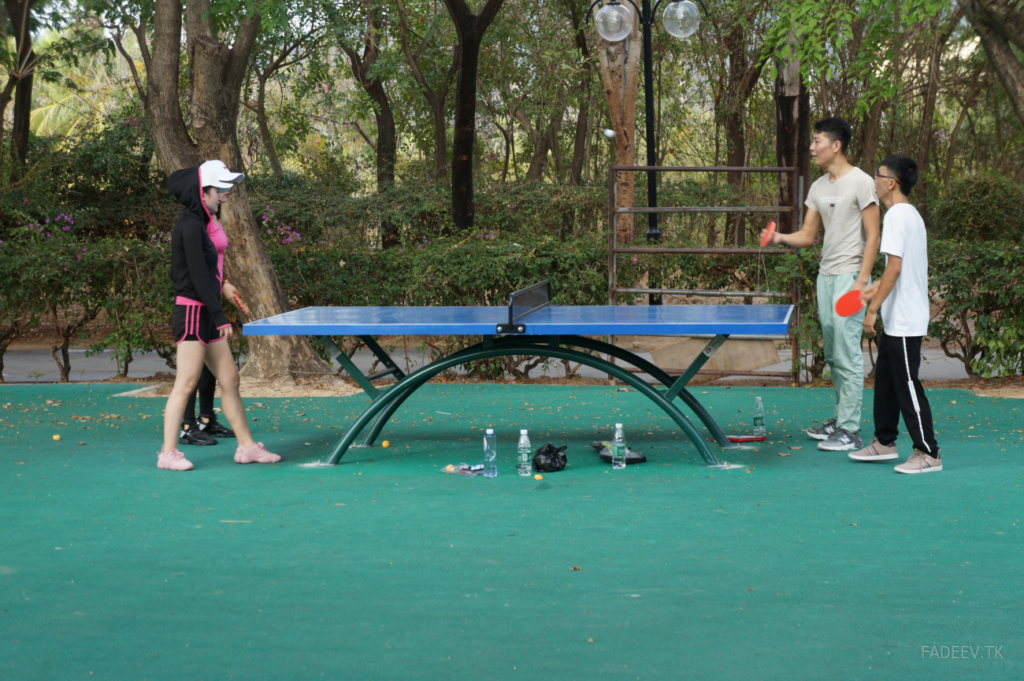 Young people play ping-pong in a park in Sanya, Hainan Island, China